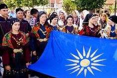 Vergina Sun A Pan-Hellenic Symbol Macedonia, youths of the macedonian diaspora at the pan-panmacedonian gathering in Greece History of Macedonia the ancient kingdom of Greece Greece History, Macedonia Greece, Ancient Greek Art, National Symbols, Greek Words, Alexander The Great, Greeks, Costumes, Traditional