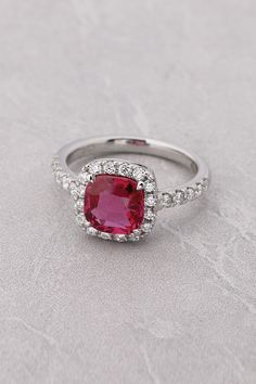 Cushion cut halo engagement ring, This blend of popular styles makes for a bold, beautiful ring.