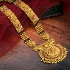 Explore the trendy collection of Gold Mangalsutra design at Waman Hari Pethe Sons. Gold Wedding Jewelry, Bridal Jewelry, Gold Jewelry, Tikka Jewelry, Sparkly Jewelry, India Jewelry, Gold Necklaces, Bridal Necklace, Jewelry Sets