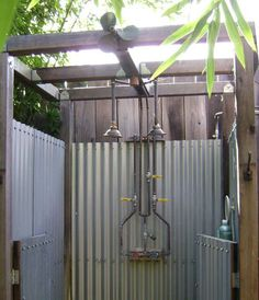 outdoor shower.  The look is perfect for the farm. Could incorporate scrap wood. Adding a roof helps for less than ideal weather.