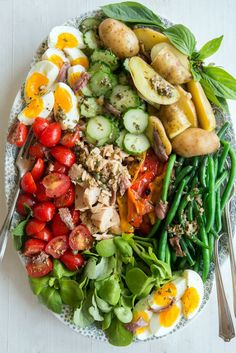 A 'Salade Nicoise'  Vinaigrette 2 small garlic cloves  8-10 basil leaves,  chopped 1/2 cup extra virgin olive oil 2 1/2 tablespoons red wine vinegar sea salt and freshly ground black pepper to taste