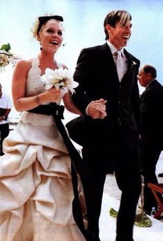 Brides.com: . P!nk's Wedding to Carey Hart, January 2006  Unsurprisingly forgoing tradition, P!nk wore a lace halter gown with a black bow-tie and bustled skirt for her Costa Rican wedding to Carey Hart.