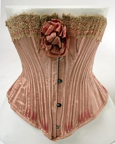 "Corset: 1904-5, French, silk. Marking: [label] (logo AB) ""Au Bon Marché/Paris"" [stamp] ""Garanti Veritable Baliene"""