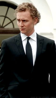 A young and still very curly Tom Hiddleston
