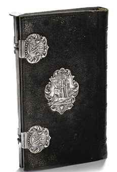 A Dutch silver-mounted fish-skin VOC note-book  Amsterdam, probably 1774, maker's mark 'IS', also stamped 'LAPRO'  Rectangular, fish skin over wooden boards, the front and back cover with central shaped oval plaque depicting an East Indiaman with V.O.C. flag enclosed by scroll and shells, two silver clasps with monogram V.O.C.R. (Rotterdam) and a silver stylus connecting the clasp and functioning as a catch  13.7 x 8 cm.