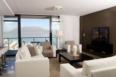 Aquarius Luxury Suites - Redefining class and sophistication, Aquarius Luxury Suites add a thrilling new dimension to the Blouberg beachfront.  These stunning, newly-built and serviced suites offer the finest furnishings, linen ... #weekendgetaways #bloubergstrand #southafrica