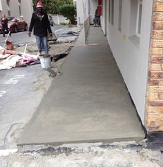 Chopped out old screeds and laid new screed to falls to rectify the waterproofing problems at a apartment block in Cape Town
