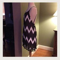 MUST HAVE SUMMER STYLE HOST PICK 7/19 Please don't buy this listing. Comment below and I will make one just for you  Adorable chevron dress in black and white with pompom trim!  Running true to size!  Love the flow and length of this piece. Good to wear into Fall especially in the South!  Small and Medium available. No PayPal No Trades Price firm unless bundled! Dresses