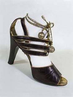 Oh my goodness. I think this is possibly the coolest shoe I've ever seen. Wow. [Open-toe strappy shoes  c.1938.]