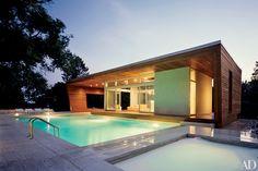 Architects Hariri & Hariri designed this contemporary ipe-paneled poolhouse