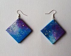 Handpainted wooden earrings, with a painting of a galaxy. It's a perfect idea for an original gift! Very light and stylish.