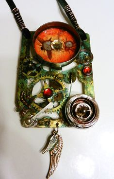Extra Large Seampunk / Victorian, Vintage Real Brass Clock Plate Pendant with gear charm, Insect image & wings & Spinning Clicking Parts. Hand painted, handmade. One of a kind.  Tarnished patina, clock gears, Insect image, faux gems,watch part detailing & dragon fly.  On 30 inch green sweater length velvet ribbon with clasp. Perfect for Cosplay.  Pendant measures 2 inch wide by 3 inches tall with wing charms hanging at bottom.  SPRING CASINGS STILL SPIN & CLICK - (When turned by hand)