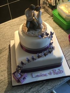 my daughters engagement cake with cake topper from willow collection