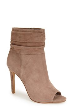 Swooning over these booties that gather at the top for a slouchy sophisticated look styled with a peep toe.