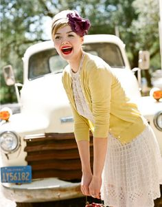Love the yellow cardigan with a simple wedding dress!  .. idk whats going on with her face but the idea is cute..