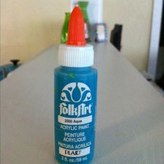 Put an old glue cap on an acrylic paint bottle to be able to write in color!