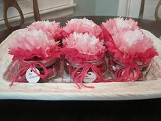 Tissue paper flower toppers with twine on mason jars.  http://www.nashvillewrapscommunity.com/blog/how-to-videos/how-to-make-tissue-flowers/