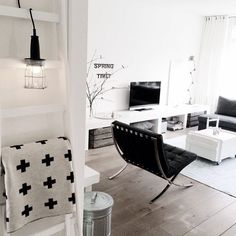 Dreaming of this monochrome living room featuring the replica Barcelona chair  perfect for any space. -Available online & in-store now- . . Image via pintrest - #design #interior #thedesignstorenz #barcelonachair #living