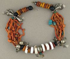 Africa | This Berber Necklace dates from early to mid 20th c. | It has been restrung within the last 10 years, but the original design was maintained. | Branch Coral, Conch Shell, Amazonite, Amber, Trade Beads, Moroccan Silver | 1995$