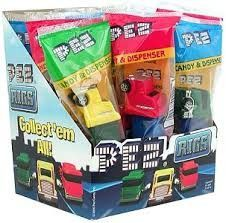 Pez Big Rig Trucks Dispenser 12 Count 3 different truck colors with container. Each individually wrapped pack comes with 1 PEZ dispenser and 2 refill PEZ cartridges. Note: Random selection is made at