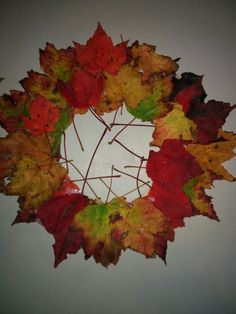 Easy Fall craft for kids ! Use a paper plate and cut the middle out, or just cut a circle out of cardboard and use white glue to glue the leaves on to make a fall wreath .