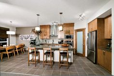 Kitchen and dining nook in Fiesta II Showhome in SkyView Ranch in north Calgary, Alberta, by Shane Homes