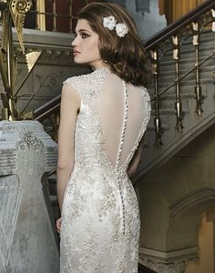 Justin Alexander 8725, Beaded metallic venice lace appliques layered over embroidered lace to create a trumpet silhouette with a Queen Anne neckline. Gown has a de...