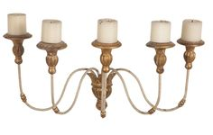 A pair of painted iron and gilt wood sconces. Circa Data: Early 20th Century