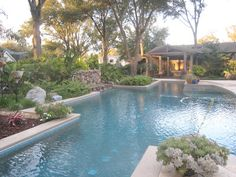 Angles and organic curves help this pool fit in with the shape of the yard.