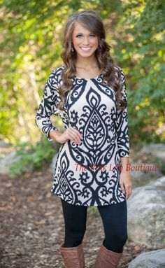 This bestselling damask tunic is back - make sure and grab it before it sells out again! This stunning black and tan tunic features a bold damask print that will stand out at any occasion, plus a chic