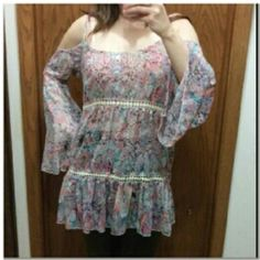 Free people style boho Tunic Floral boho sheer cold shoulder tunic with bell sleeves. Could be worn as a shirt with skinny jeans or leggings or as a dress. Size medium. NOT FREE PEOPLE, LISTED AS FOR EXPOSURE. SIMILAR STYLE. Would fit medium to large. New with tags. Open to offers. Free People Tops Tunics