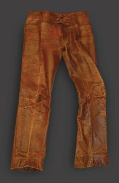 Jim Morrison: You've definitely seen these old leather trousers before. Jim Morrison wore these nearly every day for two years straight at the height of the Doors' fame. The myriad sexy photos you've seen of Morrison in leather pants? These are the very ones. He didn't have multiple pairs and he didn't wash them. The archetype of the leather-clad rock singer was established with these pants.