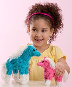 "Crochet: My Ponies and Me. Free pattern available. Skill: Easy  Size: Large Pony measures 9"" (22 7/8 cm) tall. Small Pony measures 5 1/2"" (14 cm) tall."