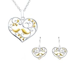 Sterling Silver Yellow Gold Bird and Vine Open Heart Two Piece Set A perfect gift for a loved one, this beautiful gift set featuresopen hearts,createdfromsterling silver with yellow gold plated bird and vine detail to complement the design.Comprising of a pair ofstud earrings, and necklace, complete with an 18 inch sterling silver chain. All items can be sold separately. All our silver jewellery is designed and crafted within our very own workshop, where a team of skilled craftsmen… Silver Jewellery, Fine Jewelry, Christmas Gift Sets, Two Piece Sets, Sterling Silver Chains, Vines, Workshop, Hearts, Stud Earrings