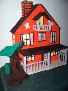 Haunted dollhouse in plastic canvas, crocheted tree