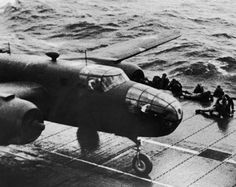 Pilot Jimmy Doolittle starting his takeoff run aboard the aircraft carrier Hornet as he begins America's first bombing raid on the Japanese mainland, the city of Tokyo.