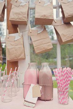 chocolate, strawberry or vanilla milk in milk bottles for serving