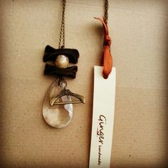 Necklace#chain#brown#leather#raku#ceramic#pearl#glass#hanger#pendant