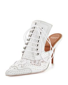 "Givenchy perforated leather and lace mule with pinked trim. 3.5"" covered heel. Pointed toe. Lace-up front. Slide-on style. Smooth outsole. ""Maremma"" is made in Italy."
