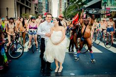 Just the other week we were reminiscing about a Philly Naked Bike Ride from years past that zipped right through a couple's wedding photos in Rittenhouse Square—and luckily for us, it happened again during this year's ride on Saturday! Photographer Joe Gidjunis of Philly's JPG Photography was indeed aware that the Philly Naked Bike Ride…