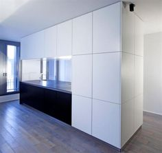 New modern black and white-kitchen island integrated with huge cabinets in wooden floor mk-040 Loft by KitcheConcept