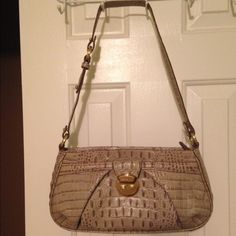 Brahmin shoulder bag Grey croc Brahmin bag. Perfect size! The length is perfect for any wallet! Purse has 1 interior zip pocket and 2 open pockets. Bag is like new, strap has a few small cracks on the sides, as pictured. Got tons of compliments on this bag! Great for fall! Brahmin Bags Shoulder Bags