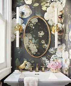 love a bold wallpaper in a small powder room.
