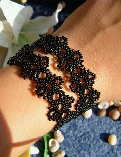 This is a free bracelet pattern at: http://store.sandradhalpenny.com/storefront.php
