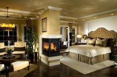 bedroom with beautiful double sided fireplace