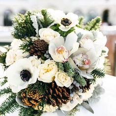 Incorporate pinecones into fall wedding bouquets