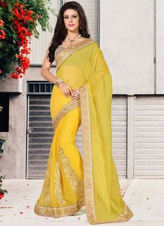 Design and style and trend will be at the peak of your attractiveness when you dresses this yellow faux chiffon and brasso designer saree. The amazing dress creates a dramatic canvas with embroidered,...