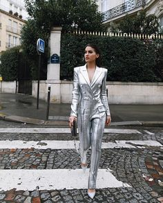 Silver jumpsuit, but really just because shes walking across the road in broad daylight just casual 😍👊