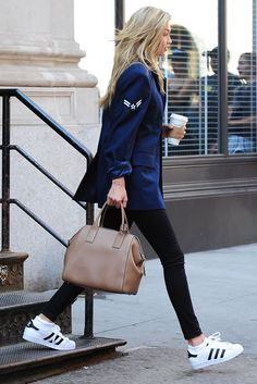Gigi Hadid in Adidas Superstar sneakers.