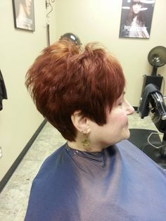 Short, smooth pixie cut, copper Aveda hair color